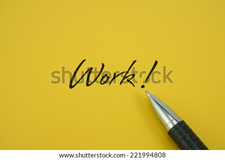 Work! note with pen on yellow background - stock photo