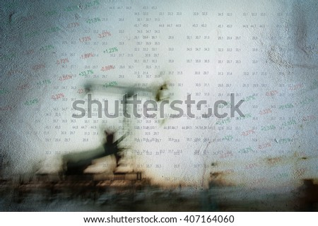 Work of oil pump jack on a oil field and finance analytics background. Textured concrete grunge, blurred motion. Numbers, figures. Concept oil and gas crisis. - stock photo