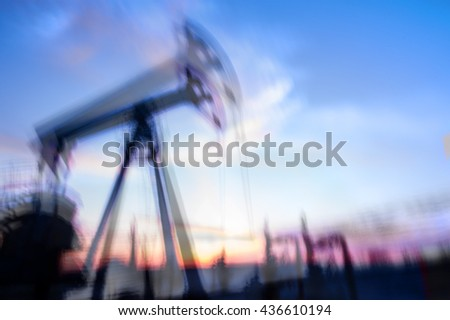 Work of oil pump jack on a oil field. Double long exposure, blurred motion.  Concept oil and gas industry. - stock photo