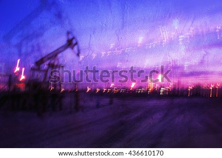 Work of oil pump jack on a oil field. Textured concrete grunge, blurred motion.  Concept oil and gas industry.