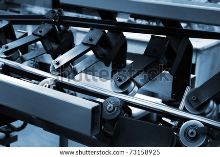 Work of the conveyor in a modern printing house - stock photo