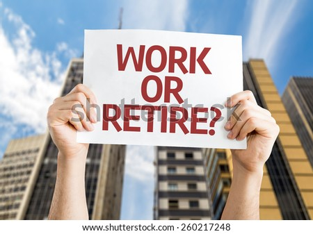 Work or Retire? card with a urban background - stock photo