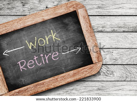 Work or Retire,the decision an aging worker must make between staying in the workforce or entering retirement  - stock photo