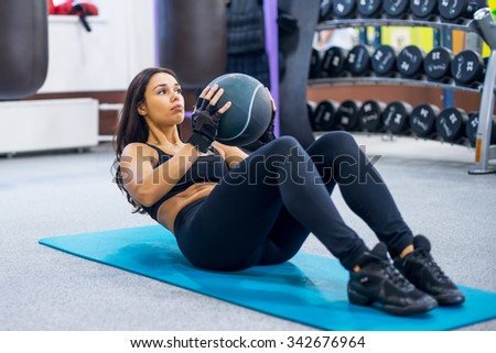 Work out fitness woman doing sit ups abs abdominal crunches core exercises with medecine ball - stock photo