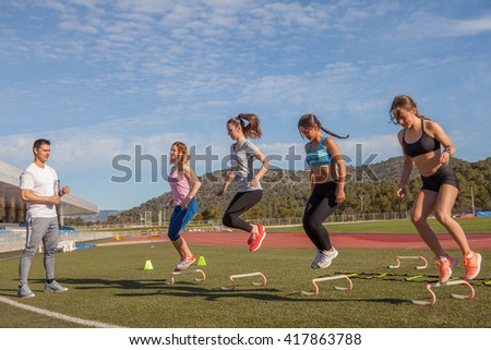 work out with fitness  training instructor - stock photo