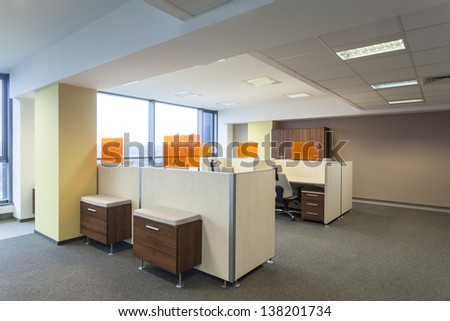 Work place and desks in a modern office interior