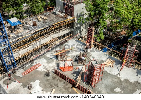 Work place- roof of an unfinished building structure - stock photo