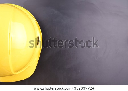 Work Place Safety Concept with safety equipment and a blackboard in the background - stock photo