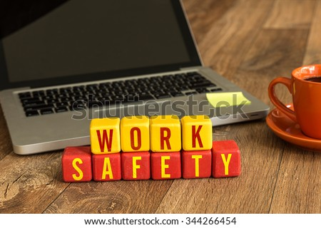 Work Safety written on a wooden cube in a office desk - stock photo