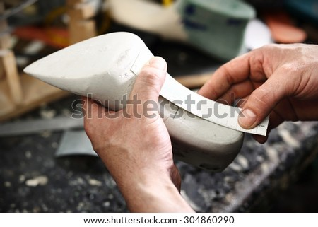 Work shoemaker, an artist craftsman.Shoemaker sews shoes - stock photo