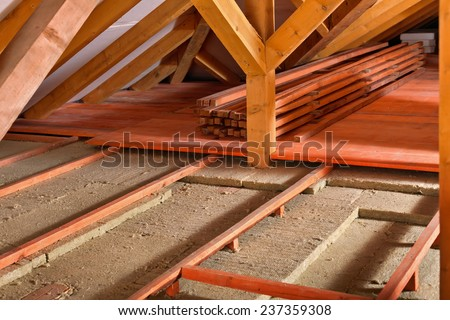 Work site for installing thermal insulation using mineral wool panels - work in progress - stock photo