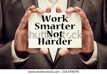 Work Smarter Not Harder Concept. Man holding a card with a motivational message text written on it