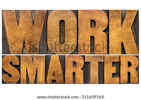work smarter word abstract - motivational advice or reminder - isolated text in letterpress wood type printing blocks