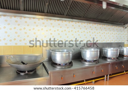 Work surface and kitchen equipment in professional kitchen - stock photo