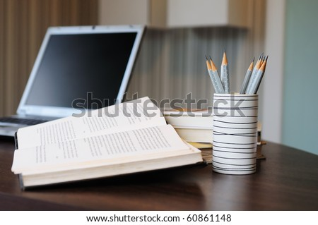 work table with computer notebook,pencil, book in a home - stock photo