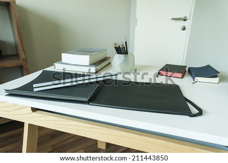 work table with measuring tools ,pencil and book in a home  - stock photo