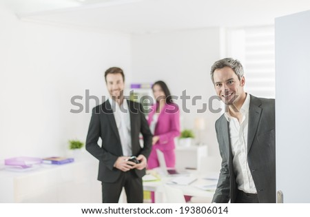 work-team at office welcoming partner - stock photo
