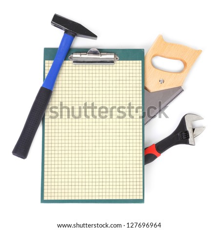 Work tools and clipboard, gentle natural shadow among objects - stock photo