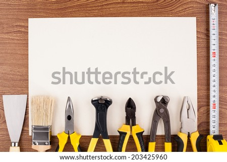 Work tools lined up on a piece of paper. - stock photo