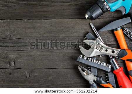 Work tools on wood close-up - stock photo