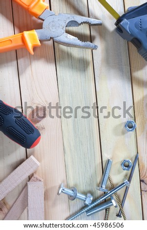 Work tools on wooden table tap with empty space in the middle - stock photo