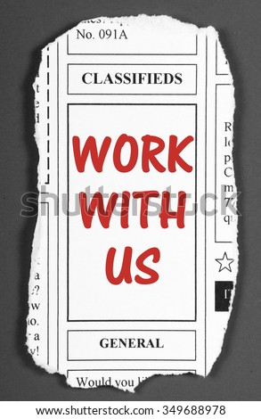 Work With Us invitation or job offer in red text on a page torn from the classified advertising section of a newspaper - processed in black and white for effect - stock photo