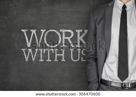Work with us on blackboard with businessman in a suit on side - stock photo