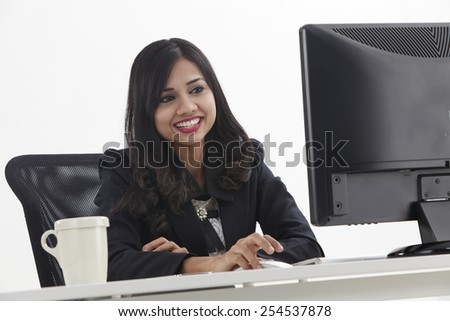 work woman in front of the computer - stock photo