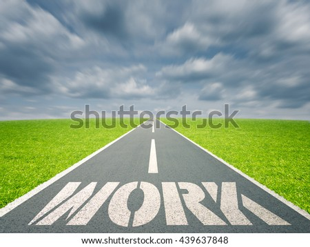 Work written on road in grass field against cloudy sky - stock photo