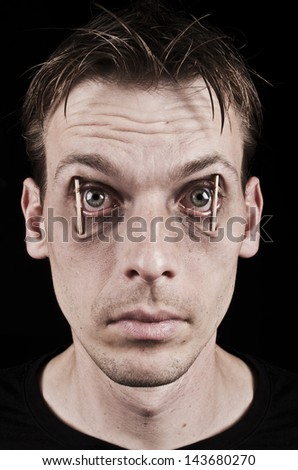 Workaholic or sleepless man. Concept of staying awake - stock photo