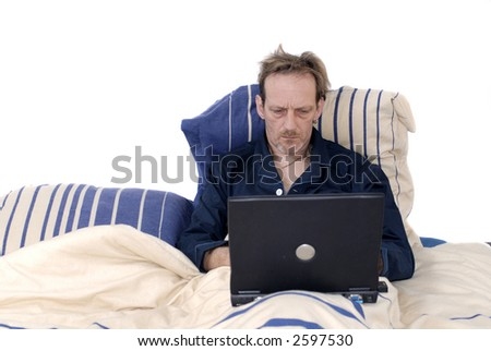 Workaholic, taking work to bed, working on  laptop. Business, stress, addiction concept.