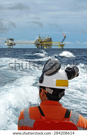 worker and oil rig background. business concept