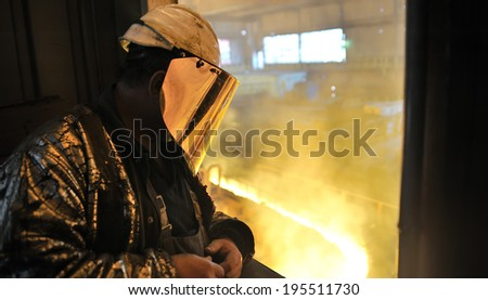 worker and  production of cast iron inside of plant - stock photo