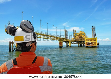 worker and rig - stock photo