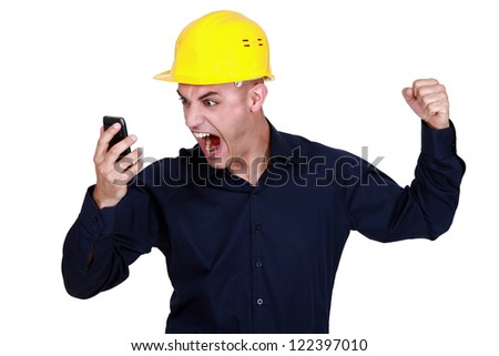 Worker angry with mobile - stock photo