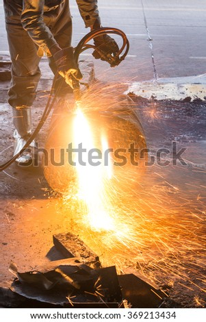 Worker are cutting steel, Background of Industry steel, Sparkles and light gas cutting.