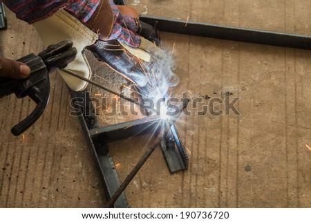 Worker are welding steel - stock photo