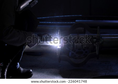 Worker argon welding