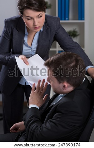 Worker being victim of psychological terror in corporation - stock photo
