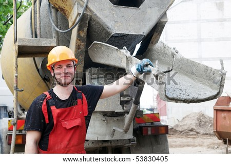 worker builder controlling concrete filling process at construction site