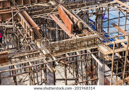 Worker Building & Construction Site in progress to new house - stock photo