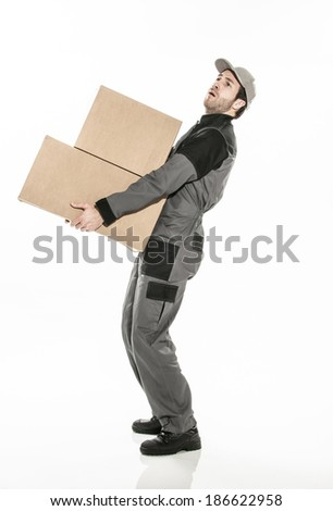 worker carrying too heavy boxes on isolated background - stock photo