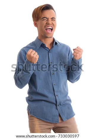 Worker celebrates with great vigor. Black man is wearing dark blue social shirt. Isolated.