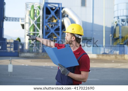 worker check control outside a modern factory - stock photo