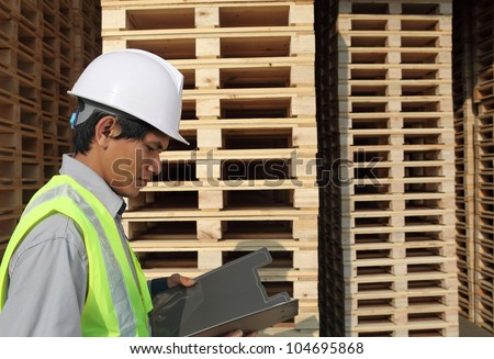 worker checking document in warehouse
