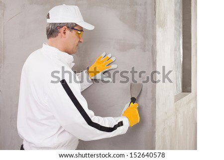 Worker checking the surface - stock photo