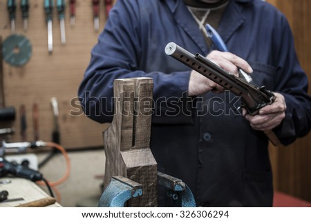 worker cleaning a gun