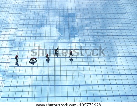 worker cleaning high tower - stock photo
