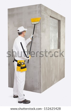 Worker cleaning the surface with a broomstick - stock photo