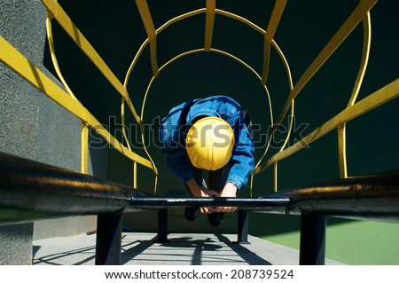 worker climbing in safety stair - stock photo